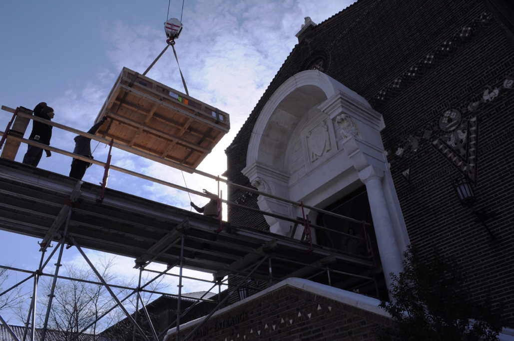 A crane hoists a crate onto Superior's platform
