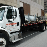 20th & JFK, trucks deliver equipment, overhead protection, Superior Scaffold, 215 743-2200